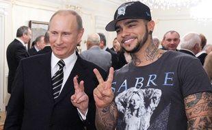 Vladimir Poutine et le rappeur russe Timati, en mars 2012.