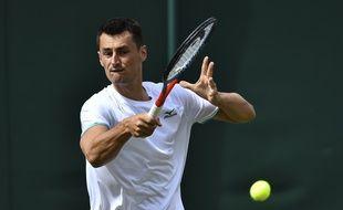 Bah alors Tomic, on joue dans le temple du tennis quand même !