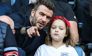 L'ancien footballeur David Beckham et sa fille Harper pendant la coupe du monde de football