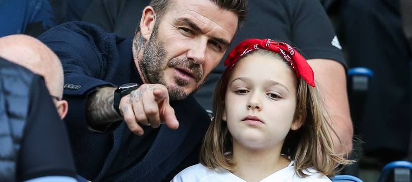 L'ancien footballeur David Beckham et sa fille Harper pendant la coupe du monde de football