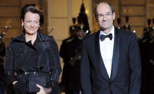Eric Woerth, alors ministre du Budget, et son épouse Florence, au Palais de l'Elysée le 2 mars 2010.