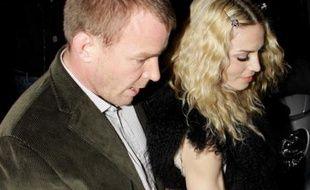 Repérés! Madonna et Guy Ritchie, pour la fête organisée pour ses 40 ans, dans son pub londonien, «The Punchbowl», le 10 septembre 2008.