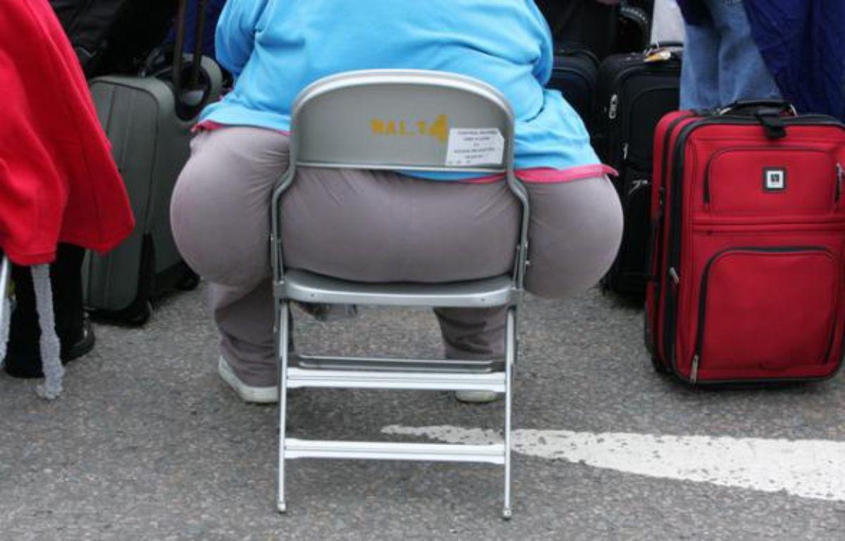 Une femme obèse à l'aéroport d'Heathrow, à Londres. –  REUTERS/Toby Melville