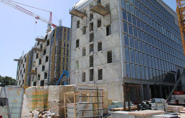 Les trois bâtiments qui enjamberont la halle Debat-Ponsan, accueilelront un hôtel Hilton Garden Inn et des bureaux