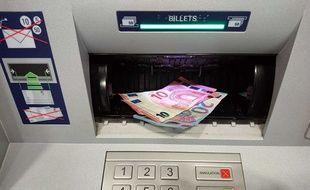 Un distributeur automatique de billets (Illustration).