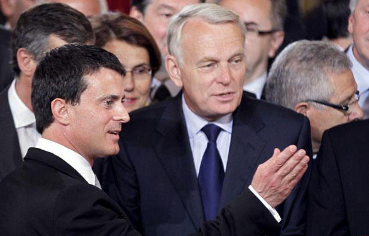 Jean-Marc Ayrault, à côté de ManuelValls, lors de l'investiture de François Hollande à l'Elysée le 15 mai 2012.  – AFP