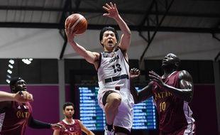 L'équipe de basket masculine japonaise lors d'un match contre le Qatar aux Jeux asiatiques, à Jakarta, le 16 août 2018.