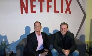 Jonathan Friedland (à gauche), désormais ex-directeur de la communication, et Reed Hastings, patron et fondateur de Netflix, le 24 novembre 2014.