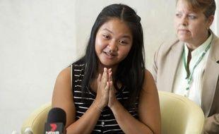 La mère porteuse Pattaramon Chanbua lors d'une conférence de presse à l'hôpital Samitivej dans la province de Chonburi, en Thaïlande, le 5 août 2014