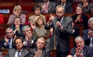 French former socialist Prime Minister Laurent Fabius poses a question duringt the weekly session of questions to the government on January 13, 2009 at the French National Assembly in Paris. Foreground are French former Socialist Party First Secretary Francois Hollande (L) and President of the Socialist Party group Jean-Marc Ayrault (2ndl).