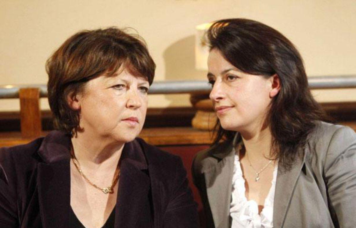 Martine Aubry (PS) et Cécile Duflot (EELV) lors d'une conférence de presse à Paris, le 18 mars 2010. – FACELLY/SIPA