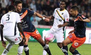 Olivier Giroud et Younès Belhanda lors d'un match contre Sochaux, le 7 avril 2012.