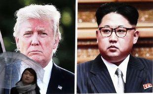 Donald Trump et Kim Jong-un s'affichent sur un écran géant à Tokyo.