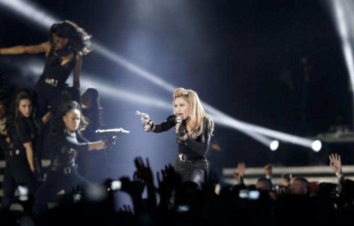 """Le Front national a déposé jeudi la plainte pour """"injure"""" annoncée depuis plusieurs jours contre Madonna, qui a projeté samedi lors d'un concert en France une vidéo dans laquelle apparaît brièvement la présidente du FN, affublée d'une croix gammée sur le front, a-t-on appris de source judiciaire. – Kenzo Tribouillard afp.com"""
