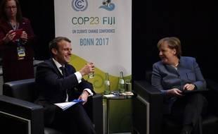 Le président français Emmanuel Macron et la chancelière allemande Angela Merkel à la conférence préparatoire à la COP 23 le 15 novembre 2017 à Bonn.