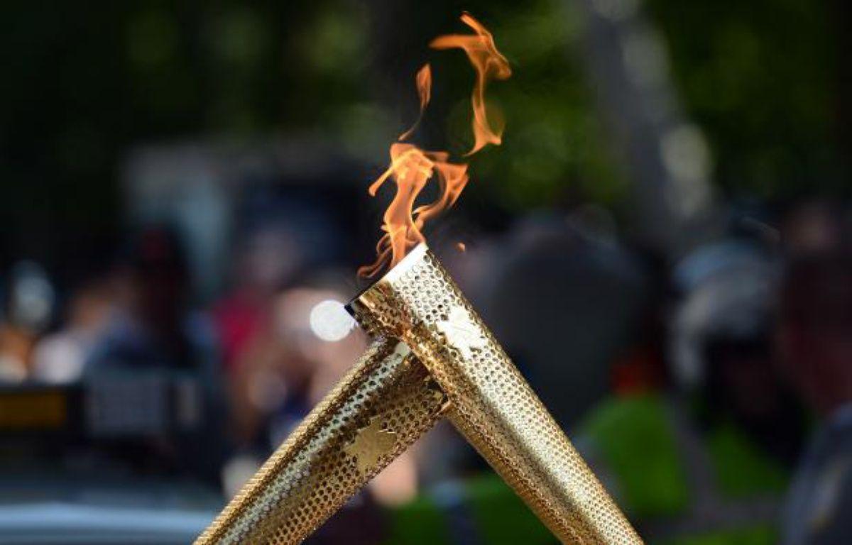 La flamme olympique, le 26 juillet 2012 à Londres. – J.Medina / AFP