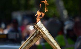 La flamme olympique, le 26 juillet 2012 à Londres.