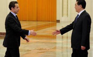 Nicolas Sarkozy rencontre le président chinois Hu Jintao le 30 mars 2011 à Pékin.