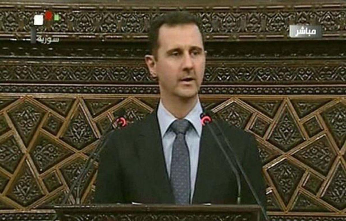 """Le président syrien Bachar al-Assad, confronté à une insurrection populaire depuis plus de 15 mois, a affirmé dimanche que son pays faisait face à un plan """"de destruction"""" en mettant de nouveau en cause """"l'étranger"""". –  afp.com"""