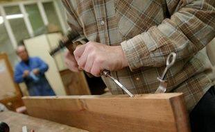 Photo d'illustration de la fabrication d'un meuble.