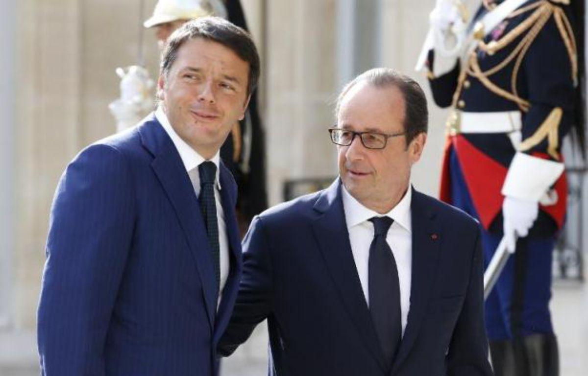 Le président français François Hollande et le Premier ministre italien Matteo Renzi, le 30 août 2014 à l'Elysée, à Paris – Kenzo Tribouillard AFP