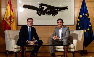 Le chef du gouvernement espagnol Mariano Rajoy (g) et le dirigeant de Ciudadanos Albert Rivera, le 12 juillet 2016 à Madrid