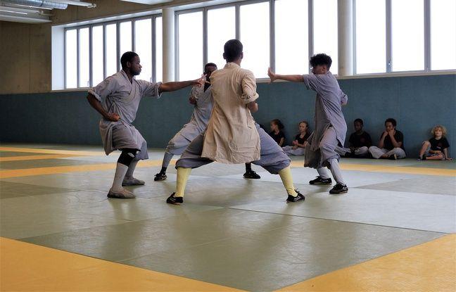 La troupe Shaolin black and white orchestre des Taolus traditionnels, à Paris 18e. Le 31 août 2018.