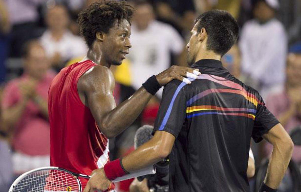Gaël Monfils et Novak Djokovic juste après la victoire du Serbe au tournoi de Montréal, le 13 aoüt 2011. – C.MUSCHI/REUTERS