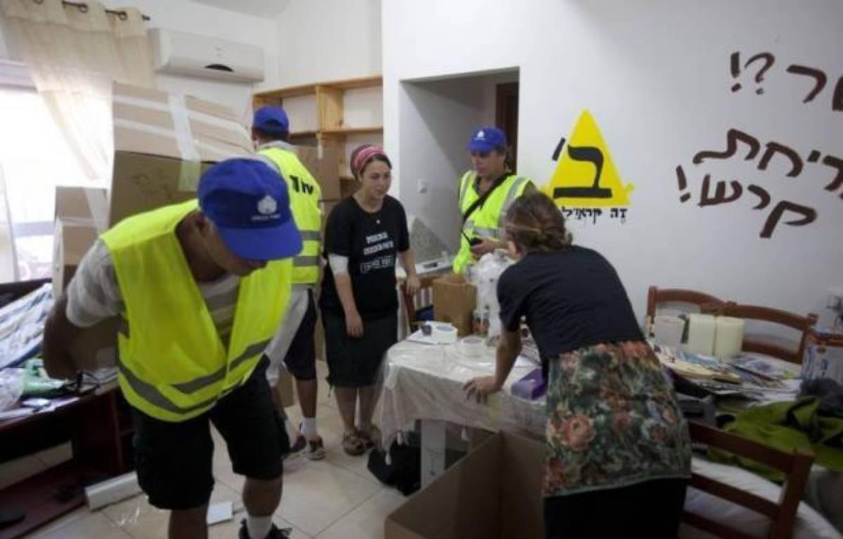 L'évacuation des colons juifs du quartier d'Oulpana, dans la colonie de Beit El (Cisjordanie), s'est achevée jeudi soir dans le calme, à la suite d'une décision de la justice israélienne, selon la police israélienne. – Menahem Kahana afp.com
