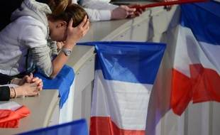 "A woman looks emotional as supporters of right-wing incumbent Nicolas Sarkozy are gathered in Paris at "" La Mutualite"" hall on May 06, 2012.The French turned out for a vote tipped to make Nicolas Sarkozy the latest European leader ousted by economic crisis and Francois Hollande the country's first Socialist president in nearly two decades. AFP PHOTO / MARTIN BUREAU"