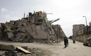 """Baba Amr à Homs, """"repaire des terroristes"""" pour le régime syrien, """"coeur de la révolution"""" pour les contempteurs de Bachar al-Assad, est aujourd'hui peuplé de fantômes qui se déplacent en silence à travers les gravats de leurs maisons."""