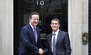David Cameron et Manuel Valls, le 6 octobre 2014 à Londres (Angleterre).