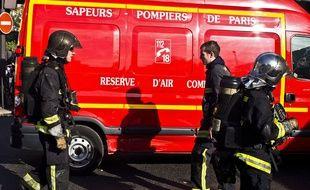 Des pompiers de Paris en action lors de l'incendie de la Maison de la Radio le 31 octobre 2014