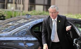Le nouveau président de la Commission européenne Jean-Claude Juncker arrive au siège de l'Union européenne à Bruxelles le 16 juillet 2014