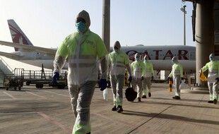Des employés de l'aéroport de Doha, au Qatar. (illustration)