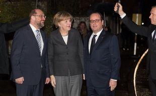 Martin Schulz, le président du Parlement européen, Angela Merkel, la Chancelière allemande et François Hollande, le Président français, avant un repas à Strasbourg le 30 janvier 2015.