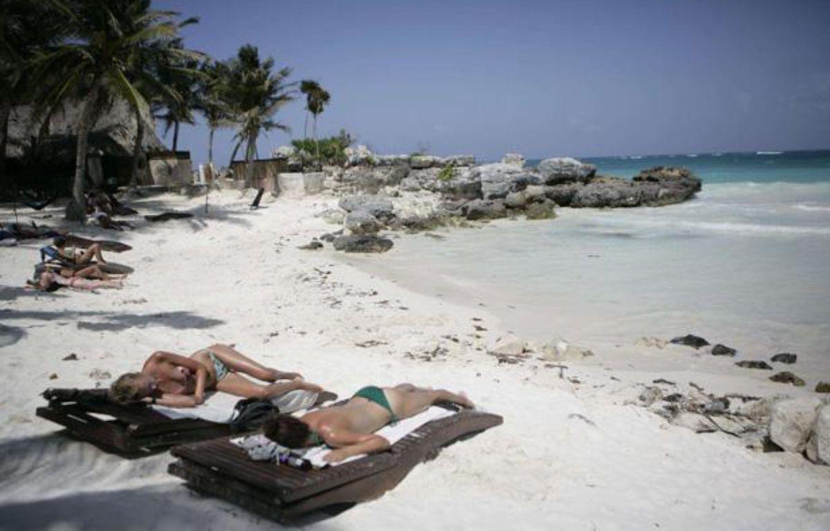 Des touristes sur une plage de la Riviera Maya, au Mexique. – Israel Leal/AP/SIPA