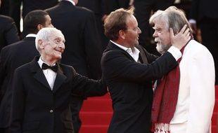 Jacques Herlin, avec Xavier Beauvois et Michael Lonsdale avant la projection du film «Des Hommes Et Des Dieux», au festival de Cannes, le 18 mai 2010.