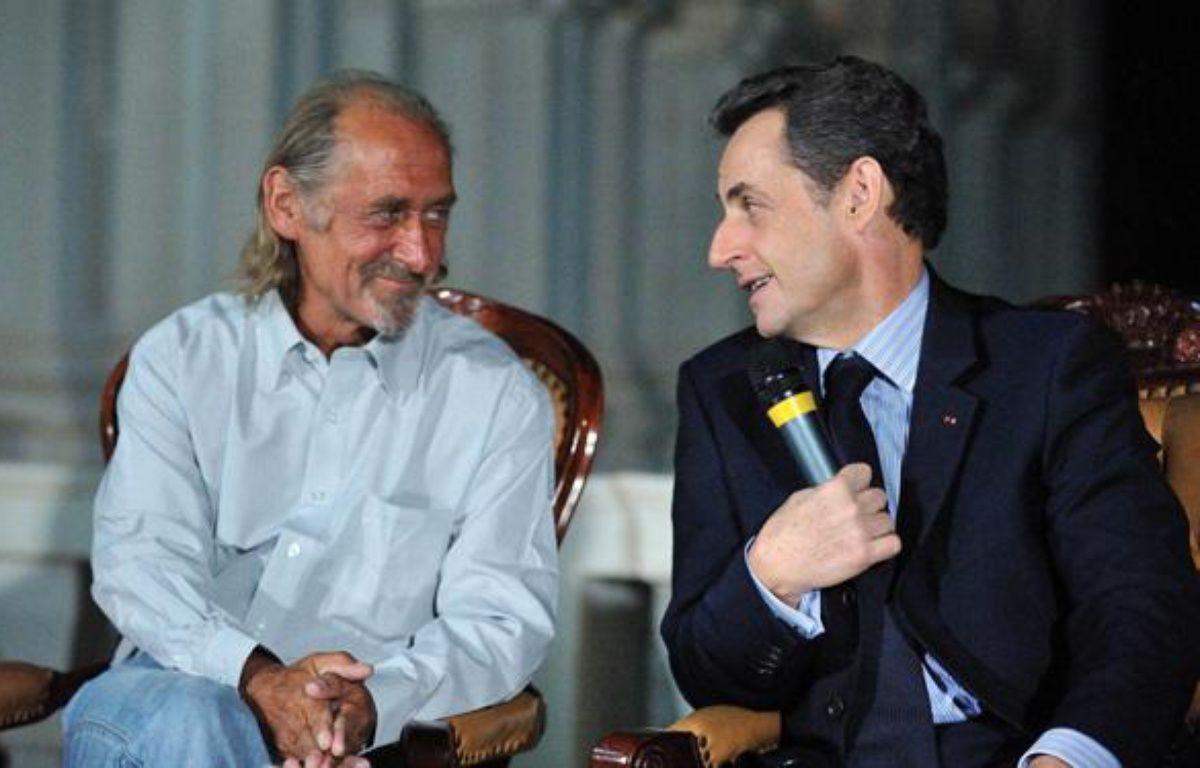 Pierre Camatte et Nicolas Sarkozy, à Bamako, lors d'une conférence de presse, jeudi 25 février. – POOL New / Reuters