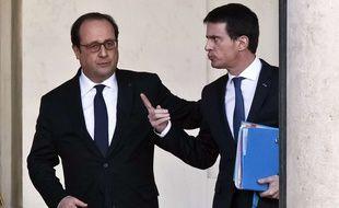 François Hollande et Manuel Valls, le 10 février 2016. AP Photo/Michel Euler, File