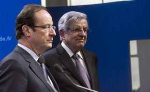 François Hollande et Jean-Pierre Chevènement, le 14 mars 2012.