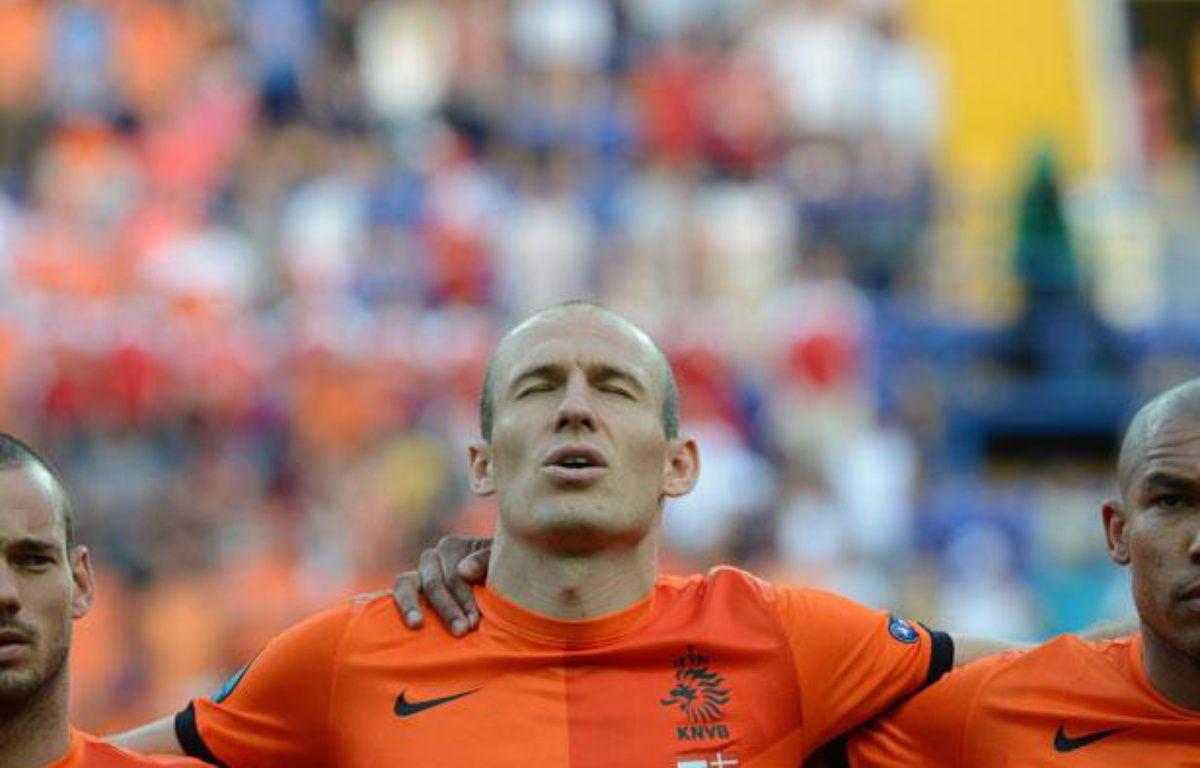 Les Néerlandais Sneijder, Robben et De Jong, le 9 juin 2012, à Kharkov. – AFP PHOTO / PATRICK HERTZOG