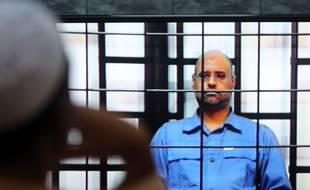 Seif al-Islam, fils de Mouammar Kadhafi, lors de son procès en mai 2014.