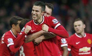 Robin van Persie fête un but lors de la victoire entre Manchester United et Chelsea le 14 décembre 2014.