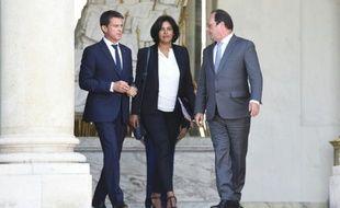 Le président François Hollande (D), le Premier ministre, Manuel Valls et la nouvelle ministre du travail Myriam El Khomri, après sa nomination, le 2 septembre 2015 à l'Elysée