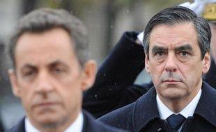 Nicolas Sarkozy, alors président de la République, et son Premier ministre de l'époque François Fillon, devant la tombe du Soldat inconnu à Paris, le 11 novembre 2010
