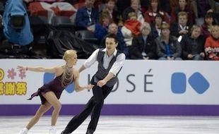 Les Russes Tatiana Volosozhar et Maxim Trankov ont pris un léger ascendant sur les grands maîtres de la catégorie couple, les Allemands Aliona Savchenko/Robin Szolkowy, quadruples champions du monde, à l'issue du programme court des Mondiaux-2013, mercredi à London (Canada).