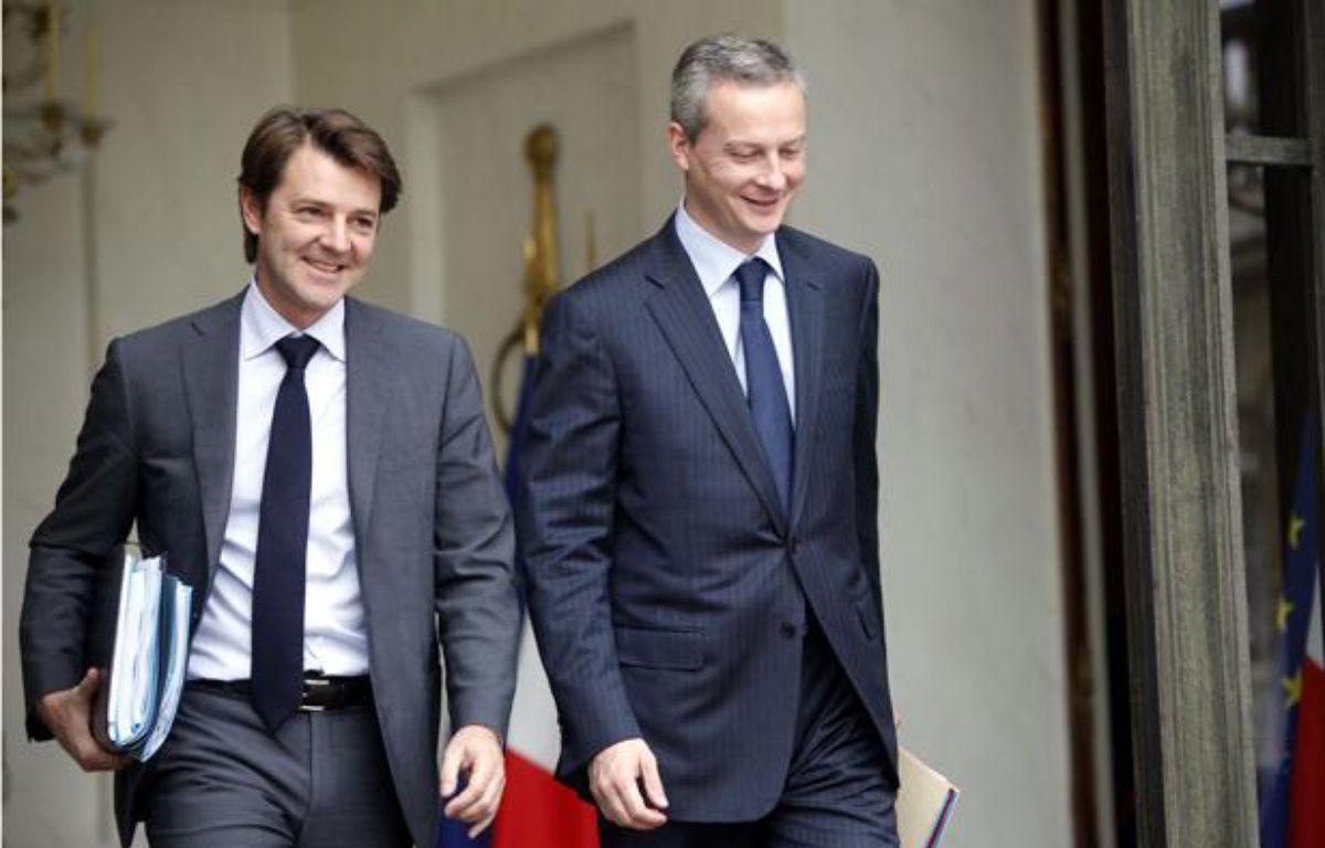 Francois Baroin, alors ministre du Budget, et Bruno le  Maire, ministre de l'Agriculture, à la sortie du Conseil des ministres à l'Elysée, le 27 octobre 2010.  – FACELLY/SIPA