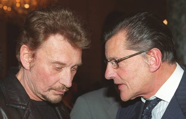 Le 16novembre 1999, Johnny Hallyday et Jean-Claude Camus,à Paris. AFP PHOTO / JEAN-PIERRE MULLER