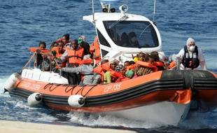 An Italian Coast Guard boat transfers rescued migrants to the Reggio Calabria harbor.